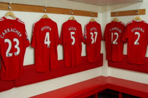 A row of Liverpool FC soccer kits.