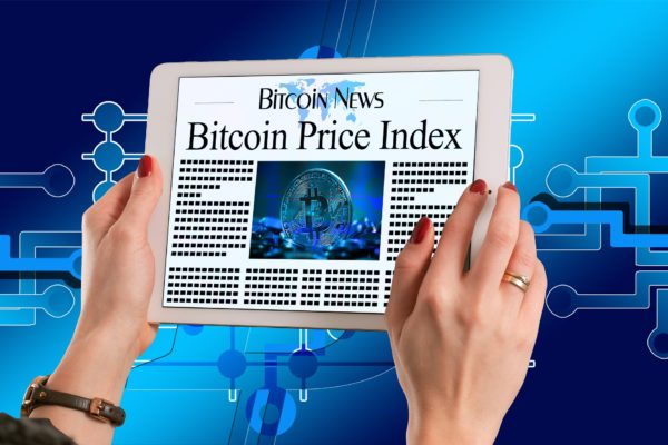 "Hands holding a tablet, headline is ""Bitcoin Price Index"""
